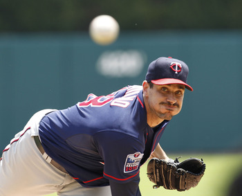 DETROIT - JULY 11:  Carl Pavano #48 of the Minnesota Twins warms up prior to the start of the game against the Detroit Tigers on July 11, 2010 at Comerica Park in Detroit, Michigan.  (Photo by Leon Halip/Getty Images)