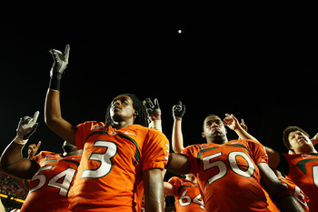 FORT LAUDERDALE, FL - OCTOBER 03: Wide receiver Travis Benjamin #3 and linebacker Darryl Sharpton #50 of the Miami Hurricanes celebrate after defeating the Oklahoma Sooners at Land Shark Stadium on October 3, 2009 in Fort Lauderdale, Florida. Miami defeat