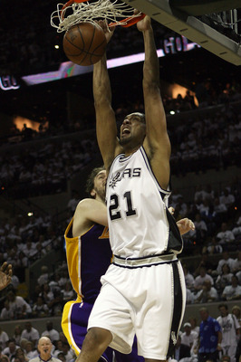 SAN ANTONIO - MAY 27:  Tim Duncan #21 of the San Antonio Spurs dunks the ball past Pau Gasol #16 of the Los Angeles Lakers in the third quarter of Game Four of the Western Conference Finals during the 2008 NBA Playoffs on May 27, 2008 at the AT&T Center i
