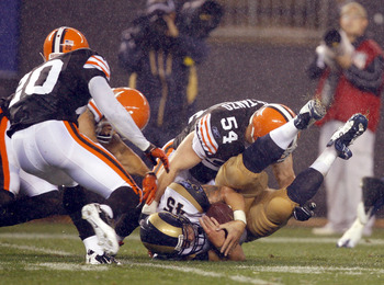 CLEVELAND - AUGUST 21:  Chris Massey #45 of the St. Louis Rams recovers a fumble as he is hit by Blake Costanzo #54 of the Cleveland Browns at Cleveland Browns Stadium on August 21, 2010 in Cleveland, Ohio.  (Photo by Matt Sullivan/Getty Images)