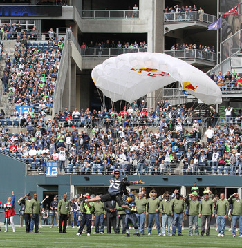 SEATTLE - SEPTEMBER 12:  A parachutist lands on the field as part of pregame ceremonies prior to the NFL season opener between the Seattle Seahawks and the San Francisco 49ers at Qwest Field on September 12, 2010 in Seattle, Washington. (Photo by Otto Gre