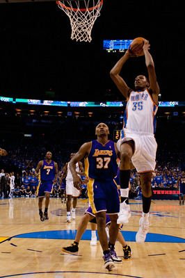 OKLAHOMA CITY - APRIL 22: Kevin Durant #35 of the Oklahoma City Thunder dunks the ball against Ron Artest #37 of the Los Angeles Lakers during Game Three of the Western Conference Quarterfinals of the 2010 NBA Playoffs on April 22, 2010 at the Ford Center