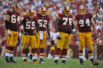 LANDOVER, MD - SEPTEMBER 19:  The Washington Redskins defense awaits the snap during the game against the Houston Texans at FedExField on September 19, 2010 in Landover, Maryland. The Texans defeated the Redskins in overtime 30-27. (Photo by Larry French/