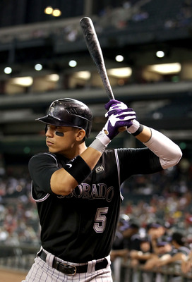 PHOENIX - SEPTEMBER 21:  Carlos Gonzalez #5 of the Colorado Rockies warms up on deck during the Major League Baseball game against the Arizona Diamondbacks at Chase Field on September 21, 2010 in Phoenix, Arizona.  (Photo by Christian Petersen/Getty Image