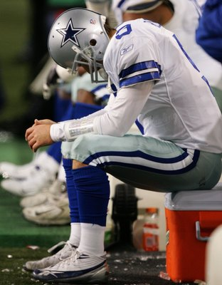 SEATTLE - JANUARY 06:  Quarterback Tony Romo #9 of the Dallas Cowboys sits dejected after fumbling the field goal snap in the fourth quarter of the NFC Wild Card Playoff Game against the Seattle Seahawks on January 6, 2007 at Qwest Field in Seattle, Washi