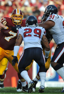 LANDOVER - SEPTEMBER 19:  Kory Lichtensteiger #78 of the Washington Redskins defends against the Houston Texans at FedExField on September 19, 2010 in Landover, Maryland. The Texans defeated the Redskins in overtime 30-27. (Photo by Larry French/Getty Ima
