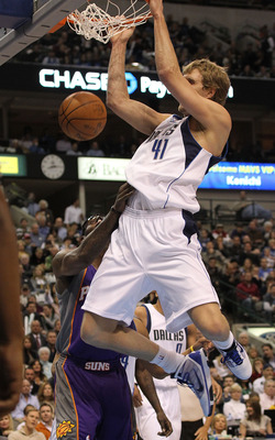 DALLAS - FEBRUARY 17:  Forward Dirk Nowitzki #41 of the Dallas Mavericks slams the ball against Amar'e Stoudemire #1 of the Phoenix Suns on February 17, 2010 at American Airlines Center in Dallas, Texas.  NOTE TO USER: User expressly acknowledges and agre