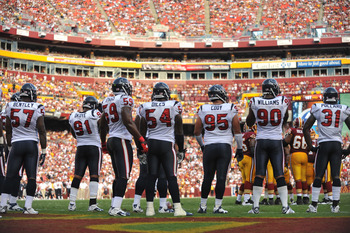 LANDOVER - SEPTEMBER 19:  The Houston Texans defense awaits the play during the game against the Washington Redskins at FedExField on September 19, 2010 in Landover, Maryland. The Texans defeated the Redskins in overtime 30-27. (Photo by Larry French/Gett