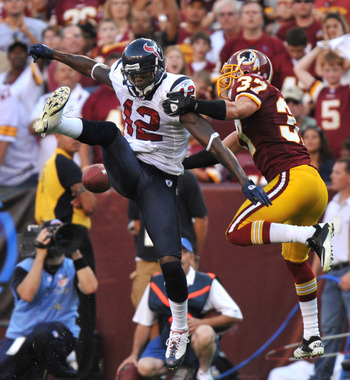 LANDOVER - SEPTEMBER 19:  Jacoby Jones #12 of the Houston Texans can't hold onto a pass defended by Reed Doughty #37 of the Washington Redskins at FedExField on September 19, 2010 in Landover, Maryland. The Texans defeated the Redskins 30-27 in overtime.