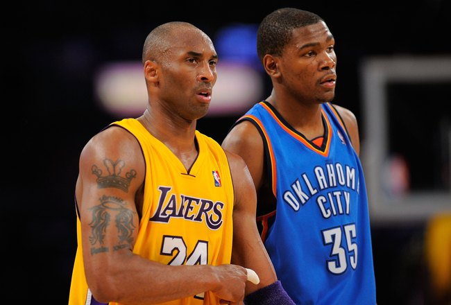 LOS ANGELES, CA - APRIL 27:  Kobe Bryant #24 of the Los Angeles Lakers stands next to Kevin Durant #35 of the Oklahoma City Thunder during Game Two of the Western Conference Quarterfinals of the 2010 NBA Playoffs at Staples Center on April 27, 2010 in Los