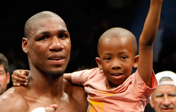 LAS VEGAS - APRIL 11:  Paul Williams holds his son Paul Williams Jr. as he celebrates defeating Winky Wright in a unanimous decision in their middleweight bout at the Mandalay Bay Events Center April 11, 2009 in Las Vegas, Nevada.  (Photo by Ethan Miller/