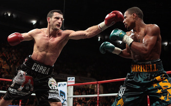 NOTTINGHAM, ENGLAND - OCTOBER 17:  Carl Froch (L) connects with a left jab as he retains his title against Andre Dirrell during their WBC Super Middleweight fight on October 17, 2009 at Trent FM Arena in Nottingham, England.  (Photo by John Gichigi/Getty