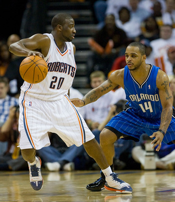 CHARLOTTE, NC - APRIL 26:  Raymond Felton #20 of the Charlotte Bobcats tries to dribble away from Jameer Nelson #14 of the Orlando Magic in Game Four of the Eastern Conference Quarterfinals during the 2010 NBA Playoffs at Time Warner Cable Arena on April