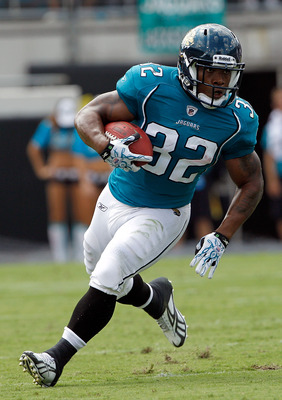 JACKSONVILLE, FL - SEPTEMBER 12:  Maurice Jones-Drew #32 of the Jacksonville Jaguars runs for yardage during the NFL season opener game against the Denver Broncos at EverBank Field on September 12, 2010 in Jacksonville, Florida.  (Photo by Sam Greenwood/G