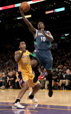 LOS ANGELES - MARCH 19: Johnny Flynn #10 of the Minnesota Timberwolves shoots over Josh Powell #21 of the Los Angeles Lakers on March 19, 2010 at Staples Center in Los Angeles, California.  The Lakeres won 104-96. NOTE TO USER: User expressly acknowledges