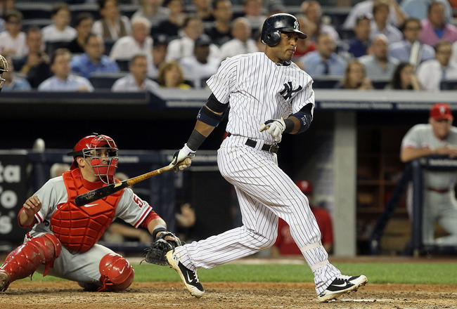 NEW YORK - JUNE 17:  Robinson Cano #24 of the New York Yankees connects on a sixth inning RBI single in the sixth inning against the Philadelphia Phillies on June 17, 2010 at Yankee Stadium in the Bronx borough of New York City.  (Photo by Jim McIsaac/Get