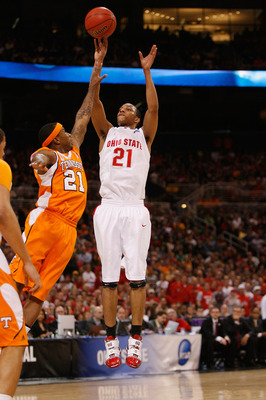 ST. LOUIS - MARCH 26: Evan Turner #21 of the Ohio State  Buckeyes shoots the ball against Melvin Goins #21 of the Tennessee Volunteers during the midwest regional semifinal of the 2010 NCAA men's basketball tournament at the Edward Jones Dome on March 26,