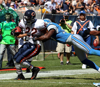 CHICAGO - SEPTEMBER 12: Matt Forte #22 of the Chicago Bears is hit by Aaron Beryy #32 of the Detroit Lions during the NFL season opening game at Soldier Field on September 12, 2010 in Chicago, Illinois. The Bears defeated the Lions 19-14. (Photo by Jonath