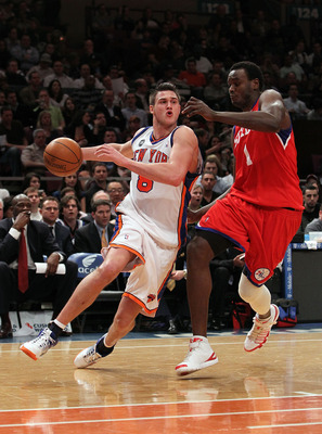 NEW YORK - MARCH 19: Danilo Gallinari #8 of the New York Knicks charges past Samuel Dalembert #1 of the Philadelphia 76ers at Madison Square Garden on March 19, 2010 in New York City. NOTE TO USER: User expressly acknowledges and agrees that, by downloadi
