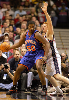 EAST RUTHERFORD, NJ - DECEMBER 14:  Mike Sweetney #50 of the New York Knicks posts up Brian Scalabrine #21 of the New Jersey Nets on December 14, 2004 at Continental Airlines Arena in East Rutherford, New Jersey. The Knicks won 87-79. NOTE TO USER: User e