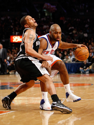 NEW YORK - FEBRUARY 08:  Mardy Collins #25 of the New York Knicks goes up against Damon Stoudamire #3 of the San Antonio Spurs on February 8, 2008 at Madison Square Garden in New York City. NOTE TO USER: User expressly acknowledges and agrees that, by dow