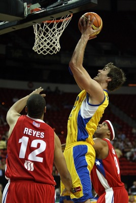 LAS VEGAS - SEPTEMBER 2:  Tiago Splitter #15 of Brazil shoots over Augelo Reyes #12 and Rick Apodaca #8 of Puerto Rico during the FIBA Americas Championship 2007 Bronze Medal game at Thomas & Mack Center September 2, 2007 in Las Vegas, Nevada.  (Photo by