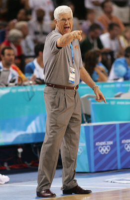 ATHENS - AUGUST 17:  Head Coach of China Del Harris shouts out orders to his players during the men's basketball preliminary game on August 17, 2004 during the Athens 2004 Summer Olympic Games at the Indoor Arena of the Helliniko Olympic Complex in Athens