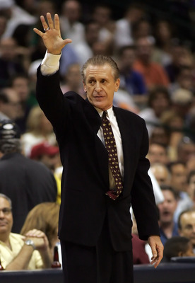 DALLAS - JUNE 08: Head coach Pat Riley of the Miami Heat puts his hand up in game one of the 2006 NBA Finals against the Dallas Mavericks on June 8, 2006 at American Airlines Center in Dallas, Texas.  The Mavericks defeated the Heat 90-80 to take a 1-0 se