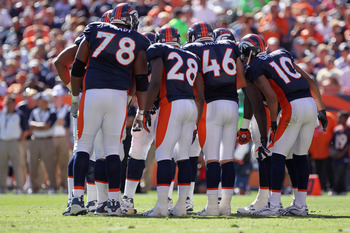 DENVER - SEPTEMBER 19:  The Denver Broncos offense huddle up as they face the Seattle Seahawks at INVESCO Field at Mile High on September 19, 2010 in Denver, Colorado. The Broncos defeated the Seahawks 31-14.  (Photo by Doug Pensinger/Getty Images)