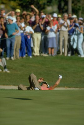 1987:  Bernhard Langer of Germany drops to the ground in elation after sinking a chip shot during the Ryder Cup at Muirfield Village in Ohio, USA. Sandy Lyle and Bernhard Langer beat Larry Nelson and Lanny Wadkins to help Europe win with a score of 15-13.