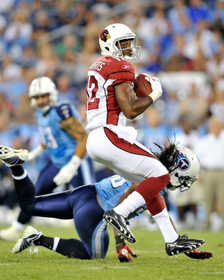 NASHVILLE, TN - AUGUST 23:  Andre Roberts #12 of the Arizona Cardinals spins out of a tackle by Vincent Fuller #22 of the Tennessee Titans during the first half of a preseason game at LP Field on August 23, 2010 in Nashville, Tennessee.  (Photo by Grant H