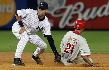 NEW YORK - JUNE 17:  Derek Jeter #2 of the New York Yankees is late with the tag as Wilson Valdez #21 of the Philadelphia Phillies steals second base in the ninth inning on June 17, 2010 at Yankee Stadium in the Bronx borough of New York City. The Phillie