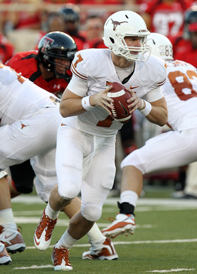 LUBBOCK, TX - SEPTEMBER 18:  Quarterback Garrett Gilbert #7 of the Texas Longhorns at Jones AT&T Stadium on September 18, 2010 in Lubbock, Texas.  (Photo by Ronald Martinez/Getty Images)