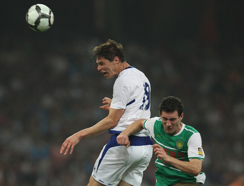 BEIJING - JULY 21:  Nikola Zigic of Birmingham City heads the ball during the 2010/11 pre-season friendly match between Beijing Guoan and Birmingham City at National Stadium as part of Birmingham City's China pre-season tour of China and Hong Kong on July