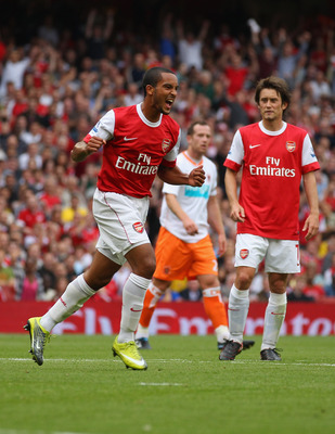 LONDON, ENGLAND - AUGUST 21:  Theo Walcott of Arsenal celebrates his third goal during the Barclays Premier League match between Arsenal and Blackpool at The Emirates Stadium on August 21, 2010 in London, England.  (Photo by Clive Rose/Getty Images)