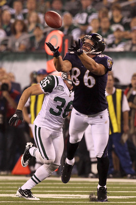 EAST RUTHERFORD, NJ - SEPTEMBER 13:  Todd Heap #86 of the Baltimore Ravens catches a pass over Jim Leonhard #36 of the New York Jets during their home opener at the New Meadowlands Stadium on September 13, 2010 in East Rutherford, New Jersey.  (Photo by J