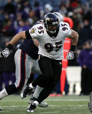 FOXBORO, MA - JANUARY 10:  Jarret Johnson #95 of the Baltimore Ravens rushes the quarterback against the New England Patriots during the 2010 AFC wild-card playoff game at Gillette Stadium on January 10, 2010 in Foxboro, Massachusetts.  (Photo by Elsa/Get