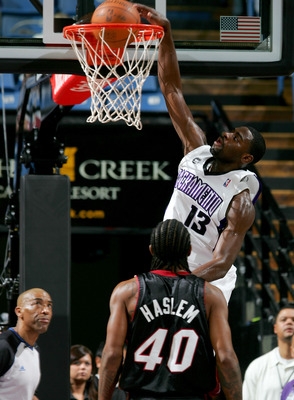 SACRAMENTO, CA - DECEMBER 06:  Tyreke Evans #13 of the Sacramento Kings dunks over Udonis Haslem #40 of the Miami Heat at ARCO Arena on December 6, 2009 in Sacramento, California.  NOTE TO USER: User expressly acknowledges and agrees that, by downloading