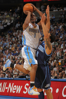 DENVER - APRIL 28:  Chauncey Billups #1 of the Denver Nuggets against the defense of Deron Williams #8 of the Utah Jazz  in Game Five of the Western Conference Quarterfinals of the 2010 NBA Playoffs at the Pepsi Center on April 28, 2010 in Denver, Colorad