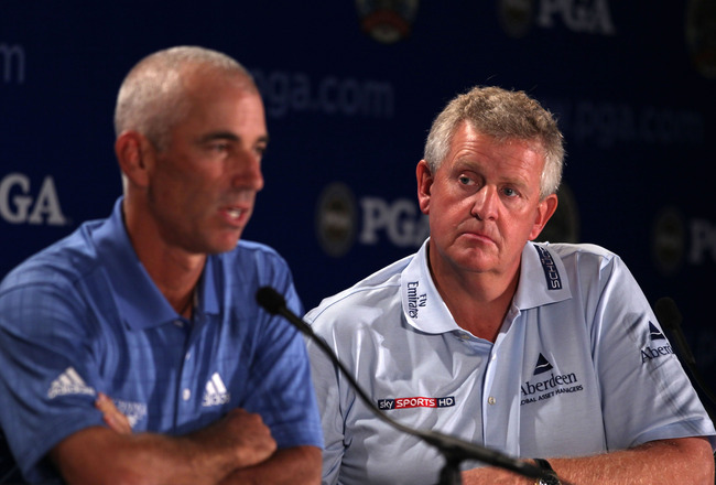 KOHLER, WI - AUGUST 11:  Colin Montgomerie of Scotland (R), European Ryder Cup Captain, looks on as Corey Pavin, United States Ryder Cup Captain, speaks to the media during a press conference prior to the start of the 92nd PGA Championship on the Straits