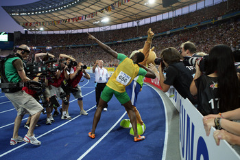 BERLIN - AUGUST 20:  Usain Bolt of Jamaica celebrates winning the gold medal in the men's 200 Metres Final during day six of the 12th IAAF World Athletics Championships at the Olympic Stadium on August 20, 2009 in Berlin, Germany.  Bolt set a new World Re