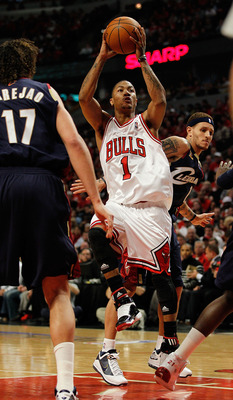 CHICAGO - APRIL 22: Derrick Rose #1 of the Chicago Bulls puts up a shot between Delonte West #13 and Anderson Varejao #17 of the Cleveland Cavaliers in Game Three of the Eastern Conference Quarterfinals during the 2010 NBA Playoffs at the United Center on