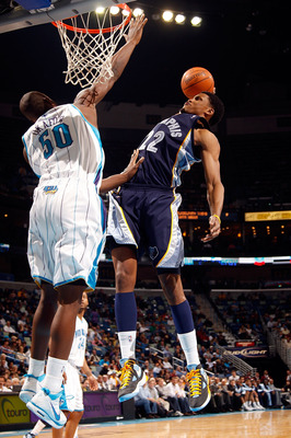 NEW ORLEANS - MARCH 03:  Rudy Gay #22 of the Memphis Grizzlies dunks the ball over Emeka Okafor #50 of the New Orleans Hornets at the New Orleans Arena on March 3, 2010 in New Orleans, Louisiana.  The Grizzlies defeated the Hornets 104-100.  NOTE TO USER: