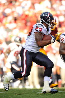 LANDOVER - SEPTEMBER 19:  Arian Foster #23 of the Houston Texans runs the ball against the Washington Redskins at FedExField on September 19, 2010 in Landover, Maryland. The Texans defeated the Redskins 30-27 in overtime. (Photo by Larry French/Getty Imag