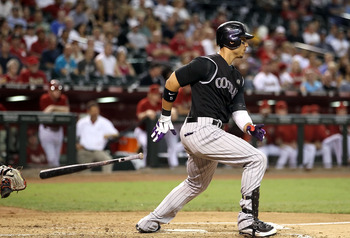 PHOENIX - SEPTEMBER 22:  Carlos Gonzalez #5 of the Colorado Rockies bats against the Arizona Diamondbacks during the Major League Baseball game at Chase Field on September 22, 2010 in Phoenix, Arizona.  (Photo by Christian Petersen/Getty Images)