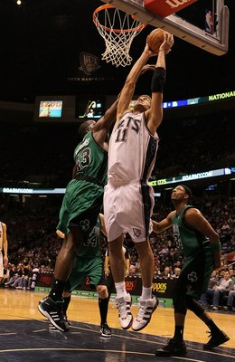 EAST RUTHERFORD, NJ - JANUARY 13:  Brook Lopez #11 of the New Jersey Nets rebounds against Kendrick Perkins #43 of The Boston Celtics during their game on January 13th, 2010 at The Izod Center in East Rutherford, New Jersey. NOTE TO USER: User expressly a