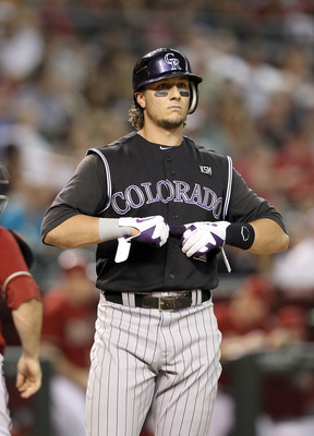 PHOENIX - SEPTEMBER 22: Troy Tulowitzki #2 of the Colorado Rockies reacts after striking out during the Major League Baseball game against the Arizona Diamondbacks at Chase Field on September 22, 2010 in Phoenix, Arizona.  (Photo by Christian Petersen/Get