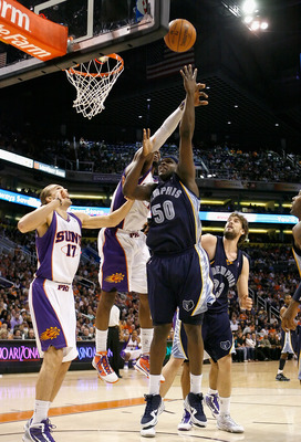 PHOENIX - NOVEMBER 25:  Zach Randolph #50 of the Memphis Grizzlies puts up a shot over Louis Amundson #17 of the Phoenix Suns during the NBA game at US Airways Center on November 25, 2009 in Phoenix, Arizona.  The Suns defeated the Grizzlies 126-111.  NOT