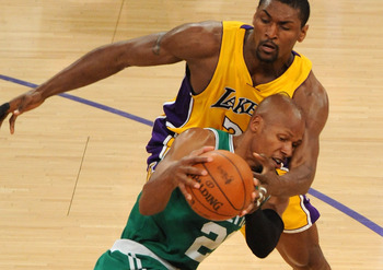 LOS ANGELES, CA - JUNE 17:  Ray Allen #20 of the Boston Celtics looks to move the ball as he is covered by Ron Artest #37 of the Los Angeles Lakers in the first quarter of Game Seven of the 2010 NBA Finals at Staples Center on June 17, 2010 in Los Angeles