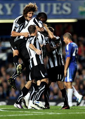 LONDON, ENGLAND - SEPTEMBER 22:  Shola Ameobi (obscured) of Newcastle is congratulated by teammates after scoring his team's third goal during the Carling Cup third round match between Chelsea and Newcastle United at Stamford Bridge on September 22, 2010